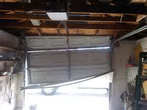 garage door repairs, damaged panel door, The Woodlands Garage Door Service