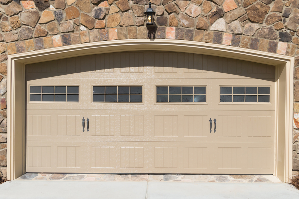New garage door installation with brick, The Woodlands Garage Door Service