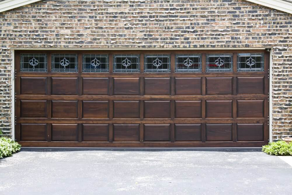 Garage Door installation, dark wood and brick, The Woodlands Garage Door Service